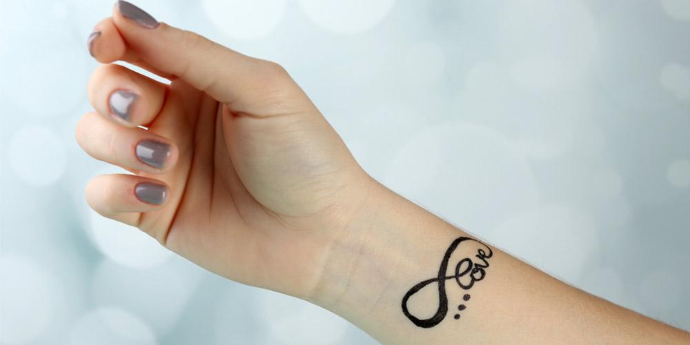طرح تاتو نوشته روی دست