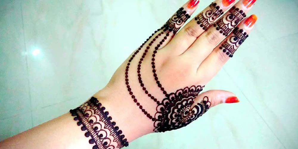 طرح حنا بر روی دست عروس